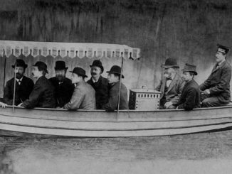 """In August 1886, Gottlieb Daimler and Wilhelm Maybach undertook the first test drives with Daimler motorboats on the Neckar near Cannstatt. The photo shows Daimler and Maybach (3rd and 2nd from the right) sitting directly by the engine housing of the """"Neckar"""""""