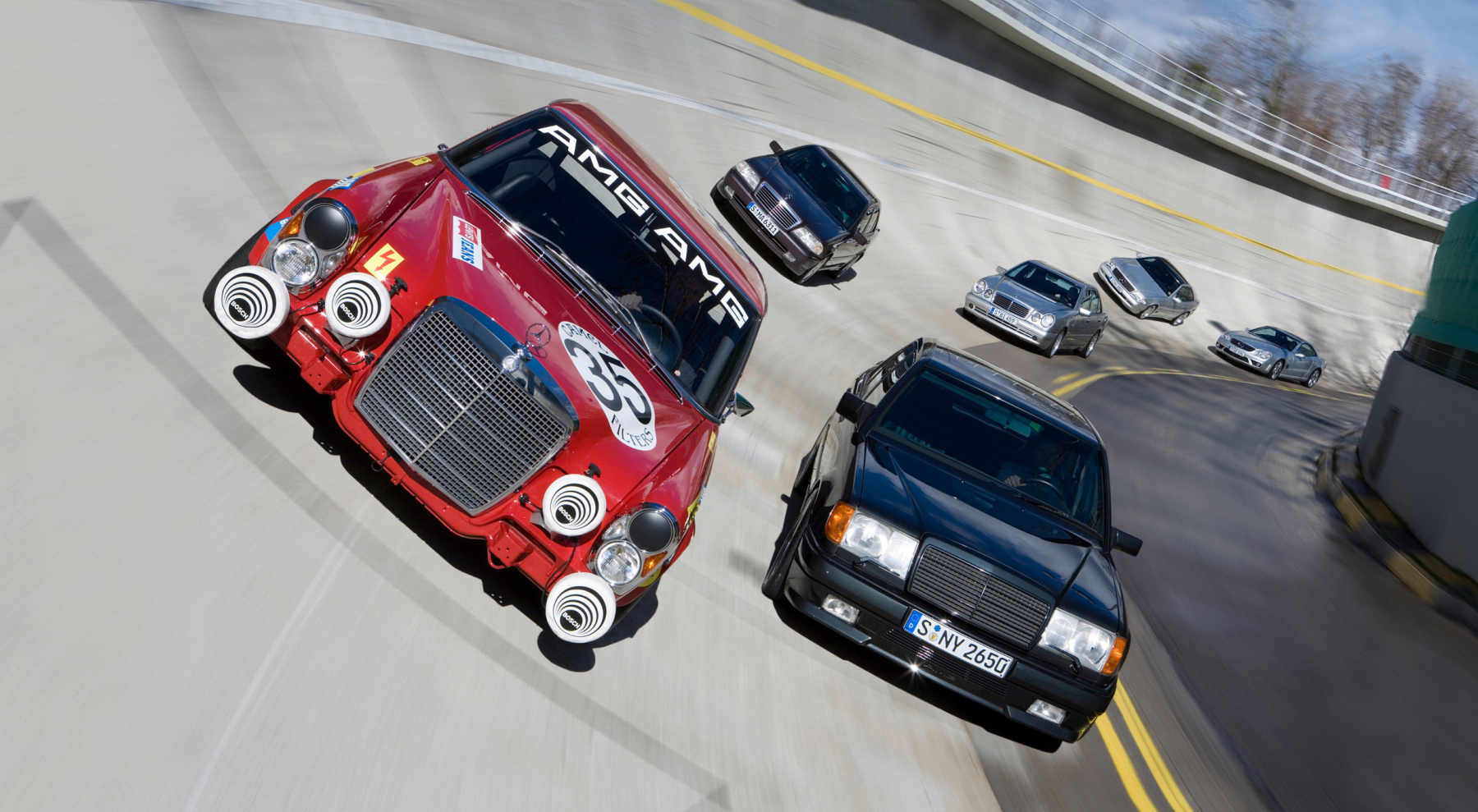 AMG 300 SEL 6.8 racing touring car based on the Mercedes-Benz 300 SEL 6.3 (W 109) luxury saloon, detailed reconstruction from 2006. The photo shows the racing touring car together with other high-performance vehicles from AMG history on the high-bank curve of the test track in Untertürkheim. Photo from 2007.