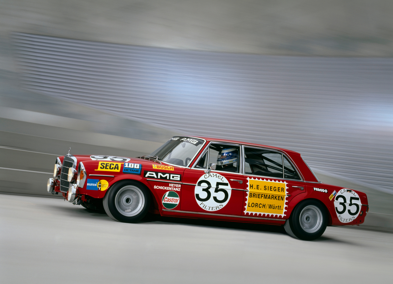 AMG 300 SEL 6.8 racing touring car based on the Mercedes-Benz 300 SEL 6.3 (W 109) luxury saloon, detailed reconstruction from 2006. Moving vehicle shot from 2006.