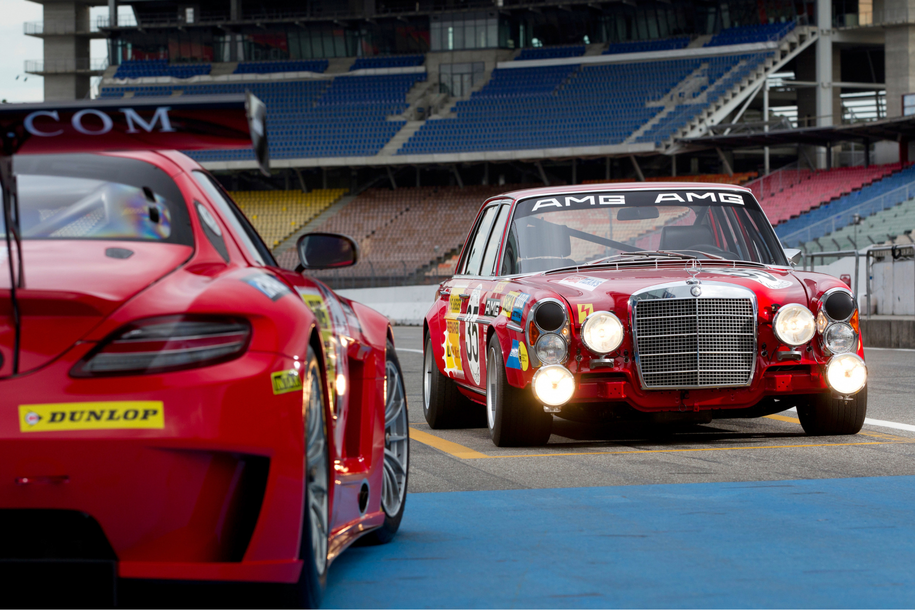 AMG 300 SEL 6.8 racing touring car based on the Mercedes-Benz 300 SEL 6.3 (W 109) luxury saloon, detailed reconstruction from 2006 (rear), and Mercedes-Benz SLS AMG GT3 racing car (C 197, front left) with a decal based on the racing touring car of 1971. Photo from 2011.