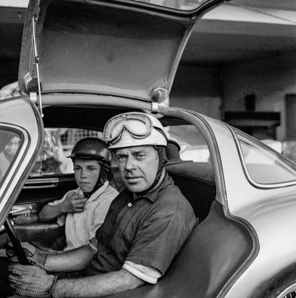 Rudolf Uhlenhaut and his son, Roger, with a Mercedes-Benz 300 SLR racing prototype for the 1956 season (W 196 S), during test drives in Monza. Photo from August 1955.